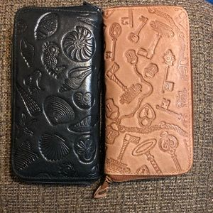 Two Michael Stevens Genuine leather wallets